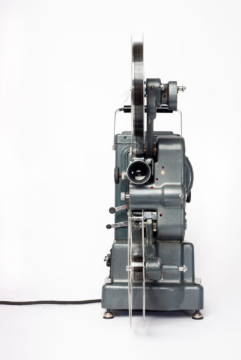Paillard-Bolex introduced the Model G projector in 1936, and it became popular in the years preceding World War II. The 'G 916' was of Swiss design and manufacture, intended for home and school use. It is a dual-gauge projector designed for both 16mm & 9.5mm film. An accompanying kit of parts, which included sprockets and rollers, enabled the user to adapt the machine to either format. The average weekly wage in 1937 was approximately £6, so this projector retailing at £45 cost a small fortune at the time.