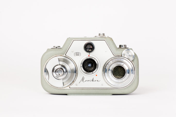 One of Zeiss's 1952-1959 series of unusually shaped 8mm cameras. Ergonomically designed to fit in the operator's hands & completely clockwork, the camera has a horizontal design, in which the film ran side to side, twisting as it crossed the gate in middle. With the option of six different frame rates, and boasting an internal light meter, this is the advanced model in the series, which came out in 1959.