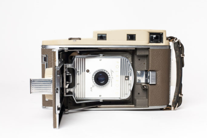 This early instant camera that used self-developing film was named a Land camera after Edwin Land, the inventor of the instant process, and was manufactured by Polaroid from 1947-1983. This is the Model 800, which was manufactured from 1957-1962. The type of film used in this camera was discontinued in 1992. Before instant digital imaging and playback, Polaroid cameras were frequently used to test studio lighting set-ups before the film cameras rolled.