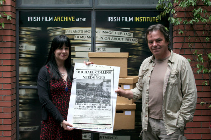 Neil Jordan donating his research and document collection to the IFI Irish Film Archive. Accepting is Kasandra O'Connell, head of IFI Irish Film Archive